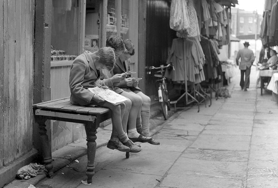 Moore Street Photograph - Boys Reading Comics In Moore Street Dublin by Irish Photo Archive