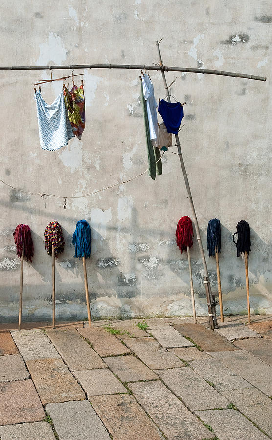 Mops and Laundry 1  Wuzhen China by Rob Huntley