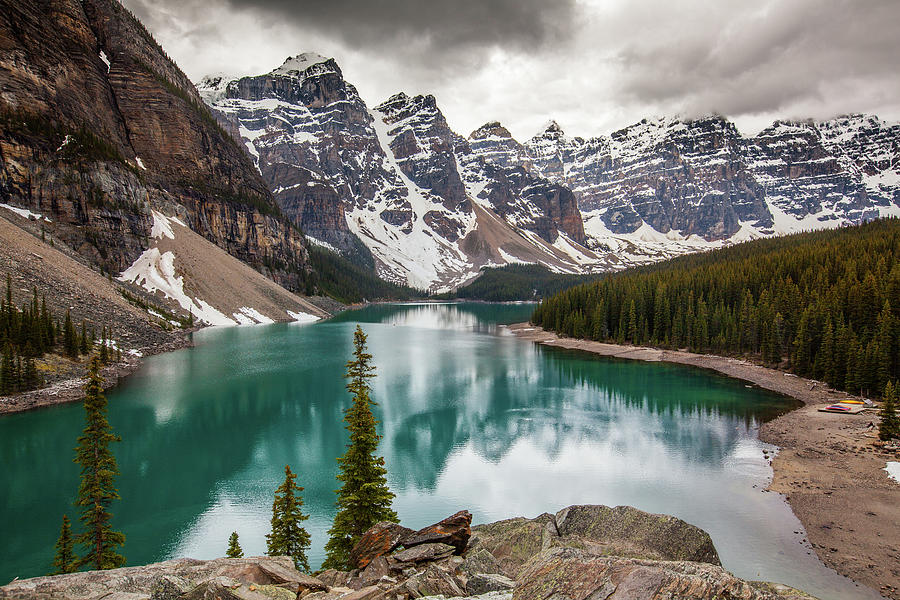 Moraine Lake On Cloudy Day Photograph by Putt Sakdhnagool