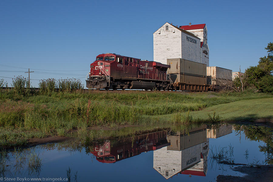 Landscape Photograph - Train Reflection At Mortlach Saskatchewan Grain Elevator by Steve Boyko