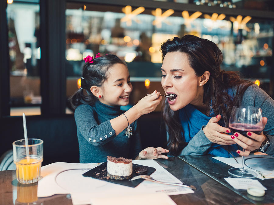 Mother and daughter in restaurant Photograph by Martin-dm