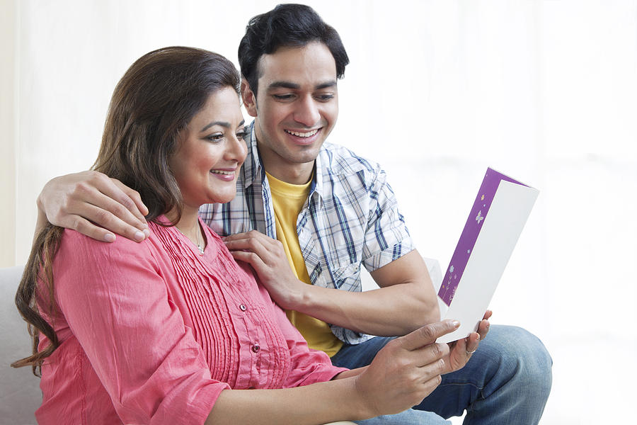 Mother reading card with son Photograph by Ravi Ranjan