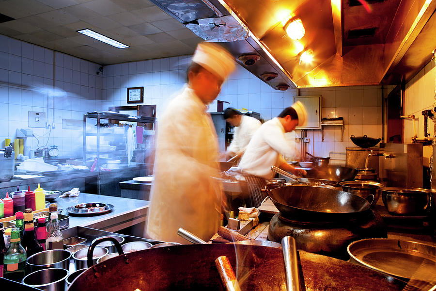 Motion Chefs Of A Restaurant Kitchen Photograph by Beijingstory