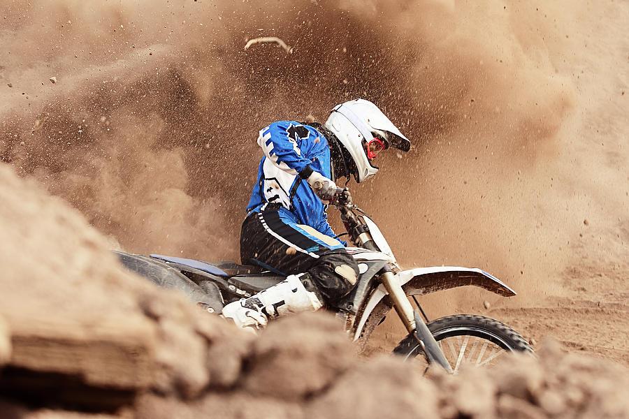 Motocross Biker Taking A Turn In The Photograph by Daniel Milchev