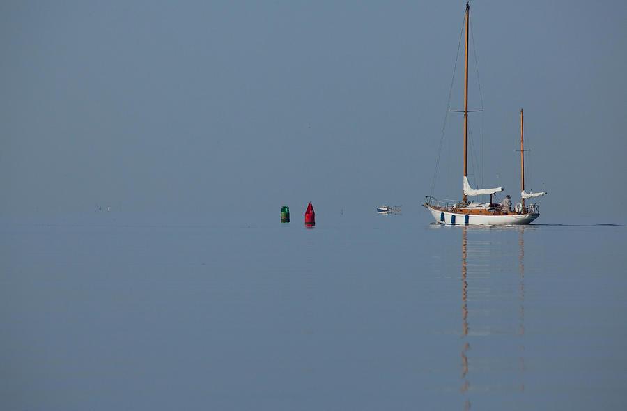 Sailboat Photograph - Motoring Sail by Karol Livote