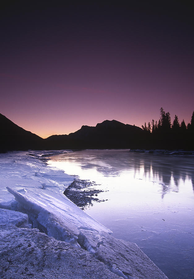 Canmore Photograph - Mount Mcgillvary Silhouetted Behind An Icy Bow River by Richard Berry