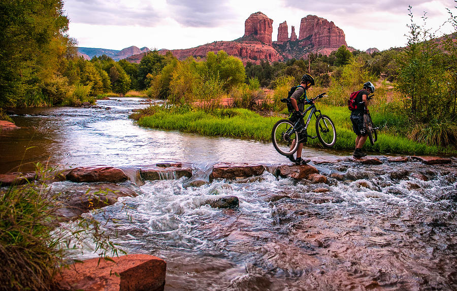 Red Rock Photograph - Mountain Bikers Crossing Cathedral Falls by Linda Pulvermacher