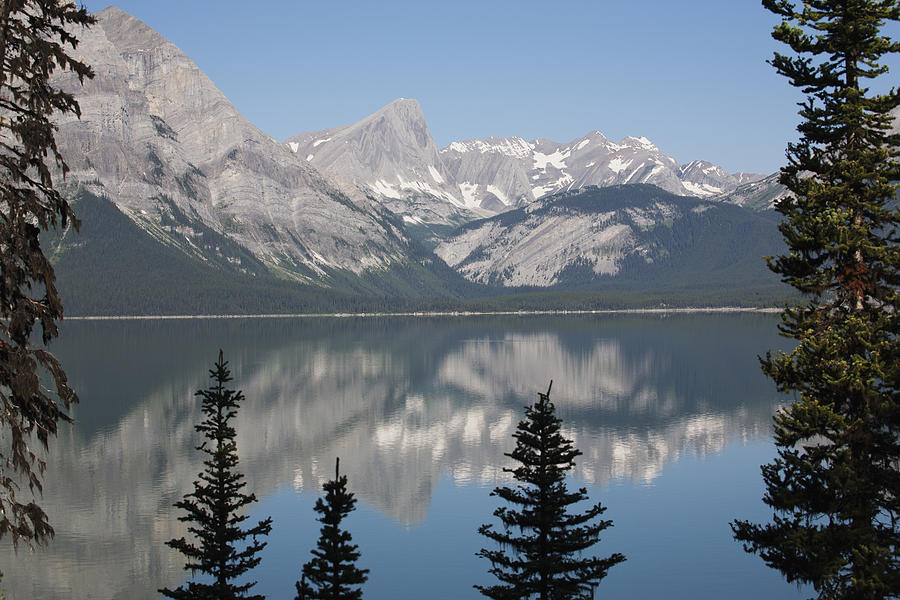 Rocky Mountains Photograph - Mountain Lake Reflecting Mountain Range by Michael Interisano