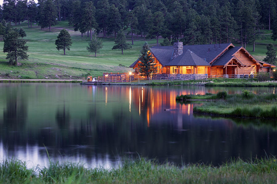 Water's Edge Photograph - Mountain Lodge Reflecting In Lake At by Beklaus