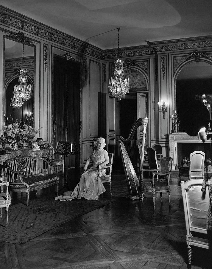 Mrs. Cornelius Sitting In A Lavish Music Room Photograph by Cecil Beaton
