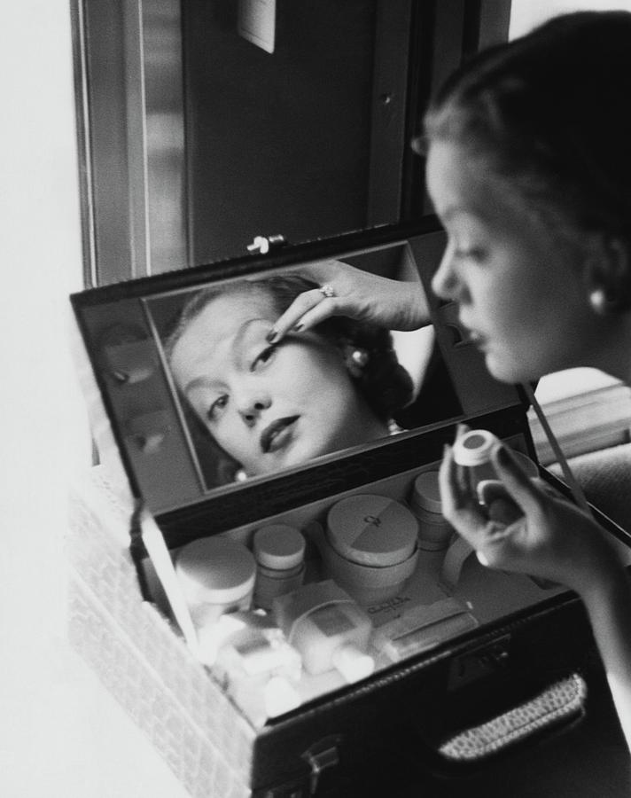 Mrs. Thomas Phipps Applying Make-up Photograph by Constantin Joffe