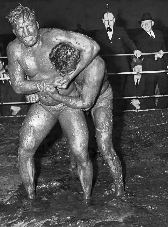 1930s Photograph - Mud Wrestling Match by Underwood Archives