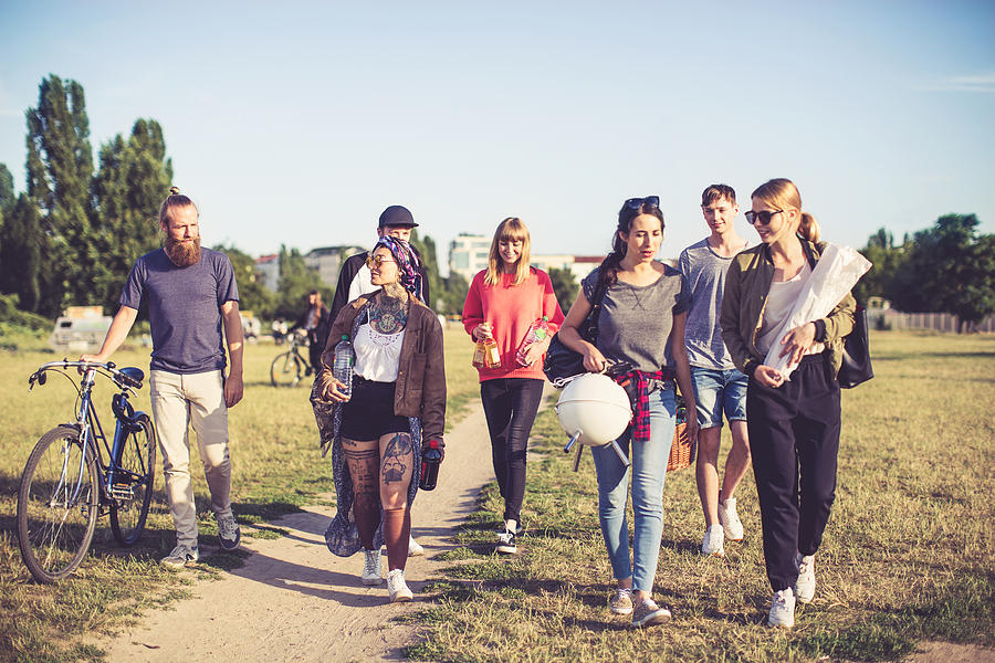Multiracial friends going on picnic Photograph by Alvarez