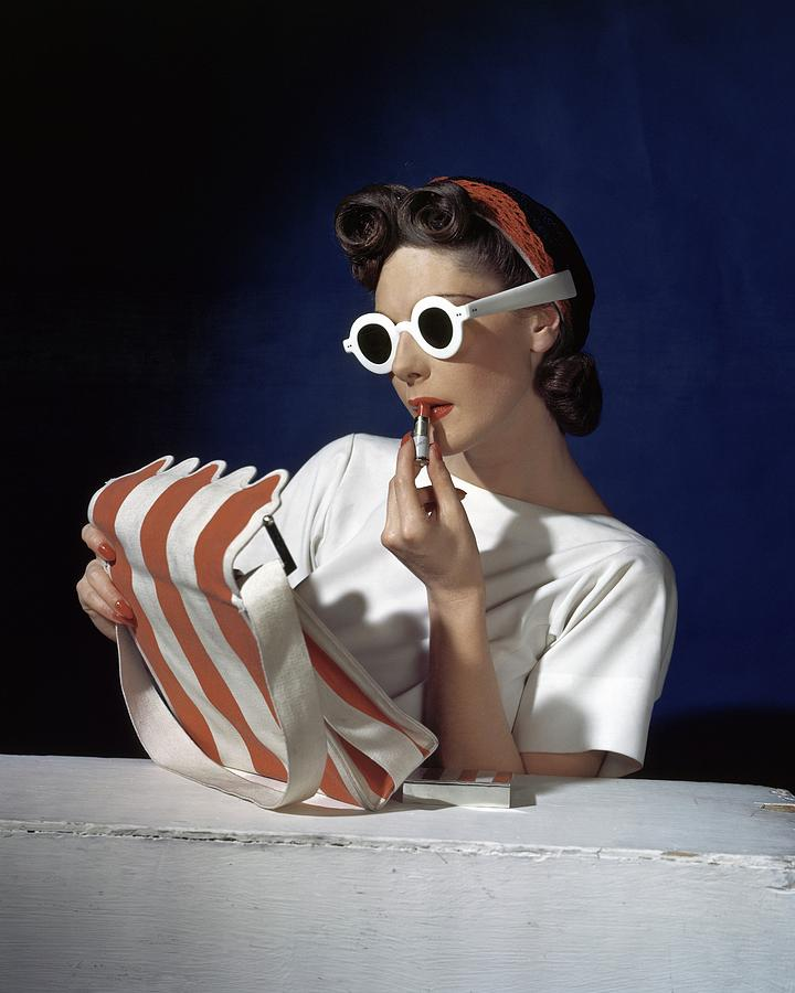 Muriel Maxel Applying Lipstick Photograph by Horst P. Horst