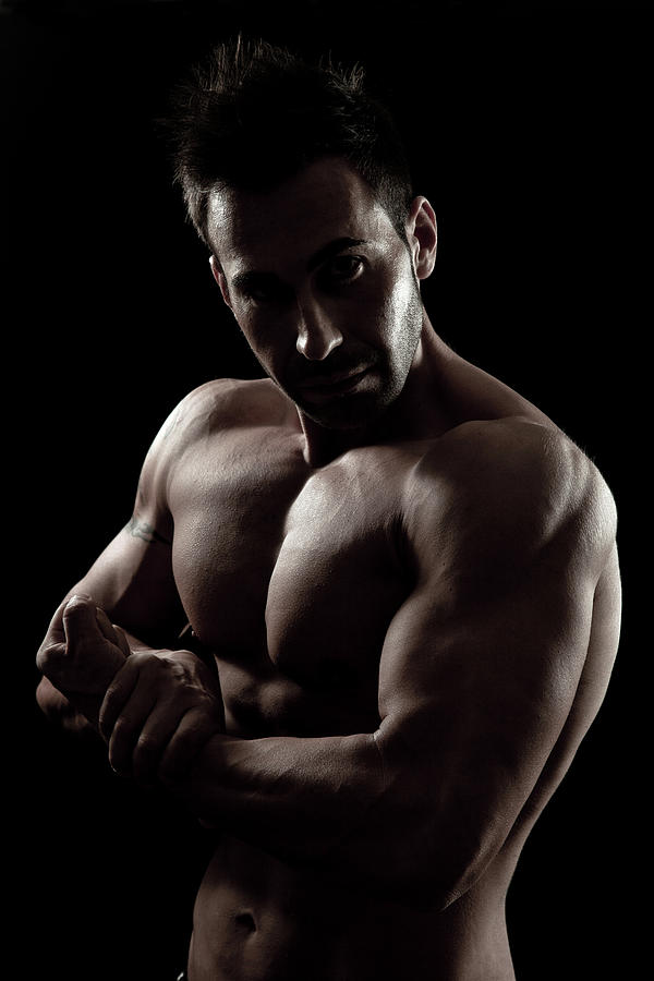 Muscular Young Bodybuilder Photograph by Leopatrizi