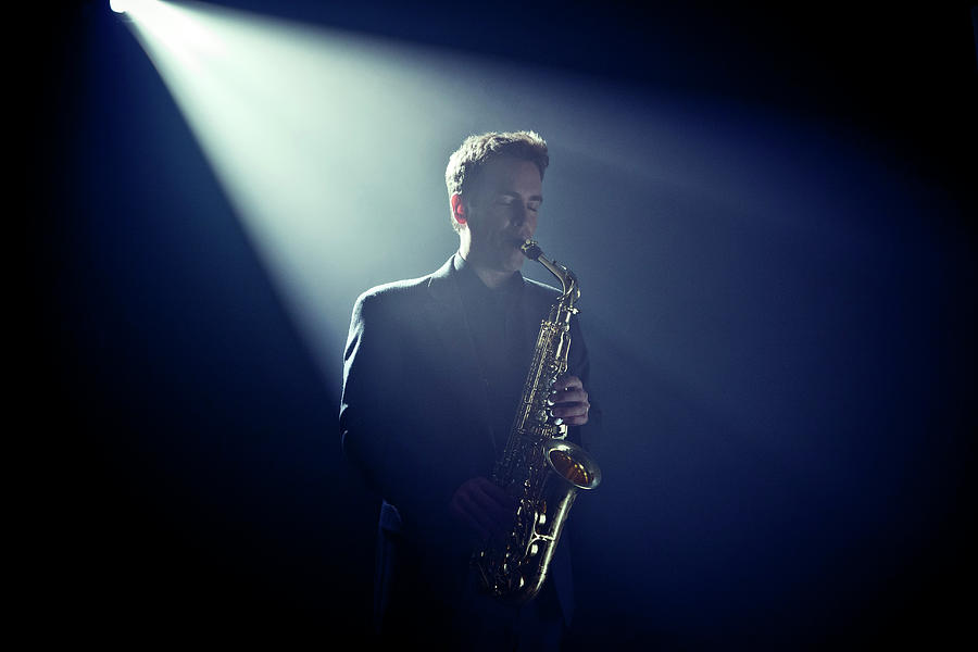 Musician Playing Saxophone On Stage Photograph by Tooga
