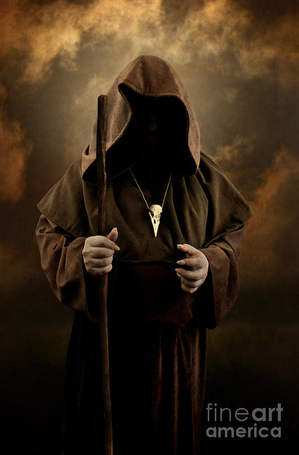 Mystery Man Wearing Cloak With Hood Bird Skull Pendant Holding A Wooden Wizard Staff
