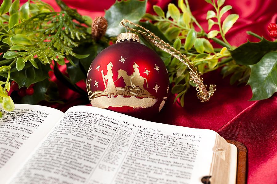 Nativity red Christmas ornament.  Open Bible. Garland. St. Luke. Photograph by Fstop123