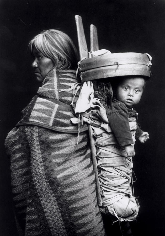 Carpenter Photograph - Navaho Woman Carrying A Papoose On Her Back by William J Carpenter