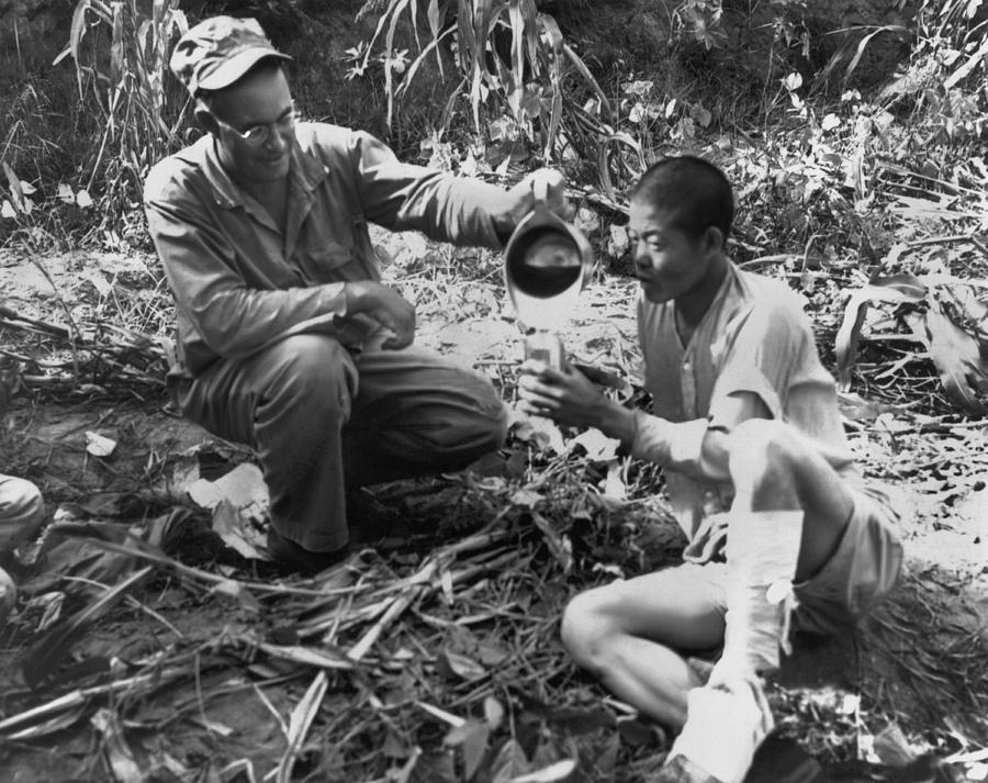 1950 Photograph - Navy Medic Assists Pow by Underwood Archives