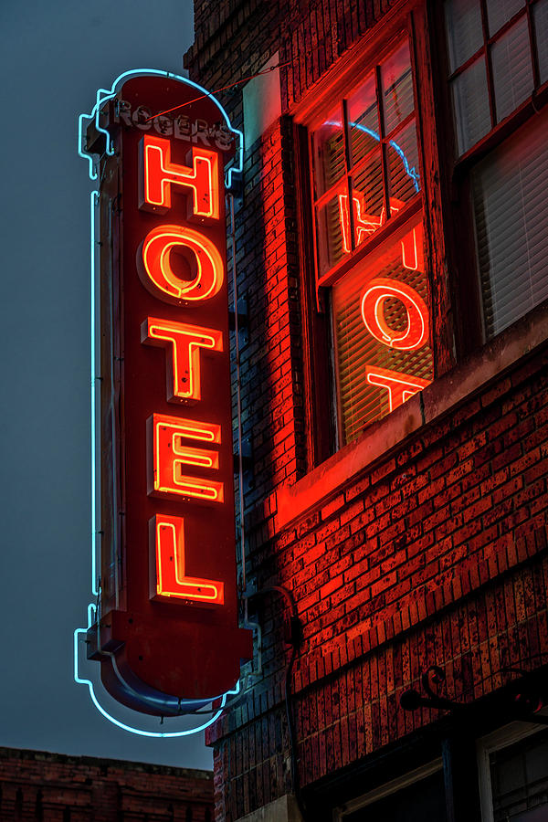 Vertical Photograph - Neon Sign For Hotel In Texas by Panoramic Images