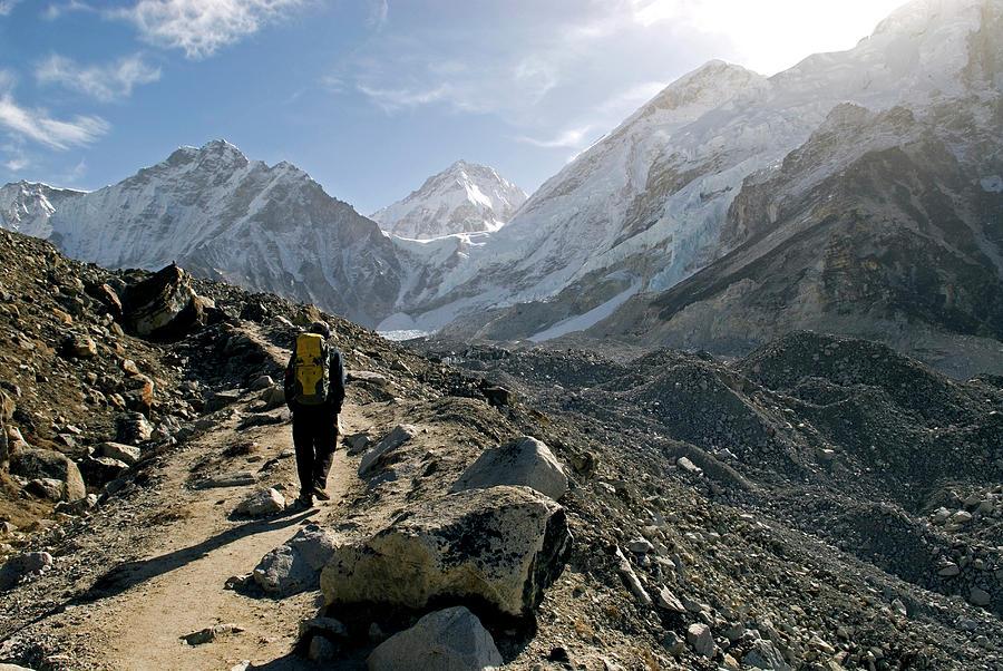 Adventure Photograph - Nepal A Trekker On The Everest Base by David Noyes