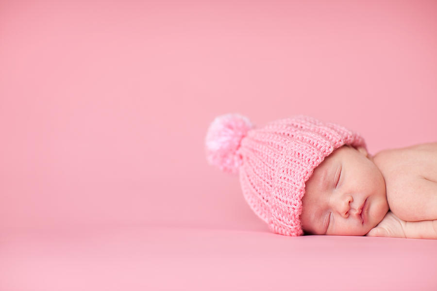 Newborn Baby Girl Sleeping Peacefully On Pink Background Photograph by Ideabug