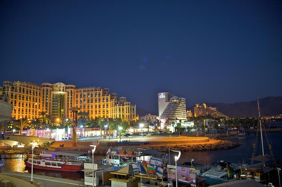 Night View Of Hotels And Boats At Red Photograph by Barry Winiker