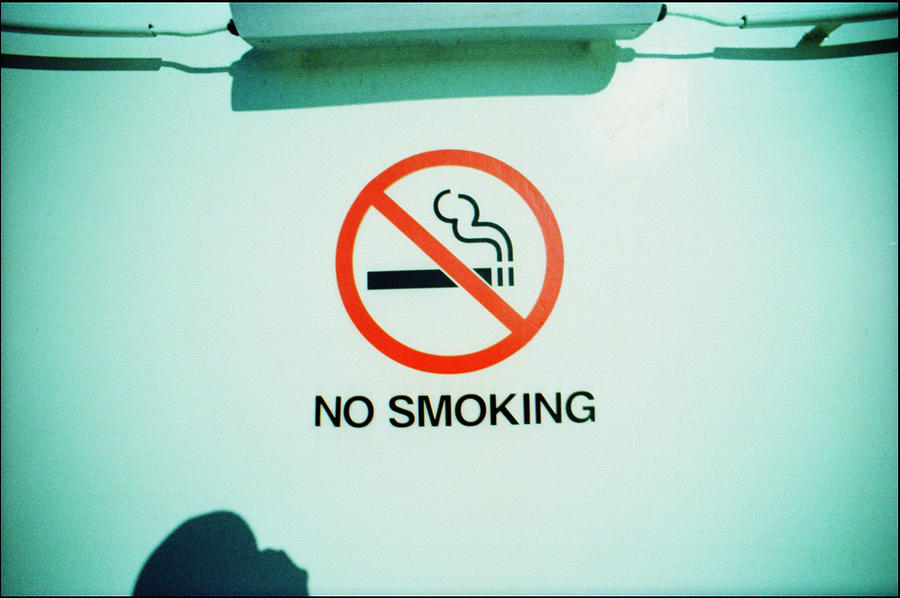 No Smoking Sigh On White Wall Photograph by Willie Schumann / EyeEm