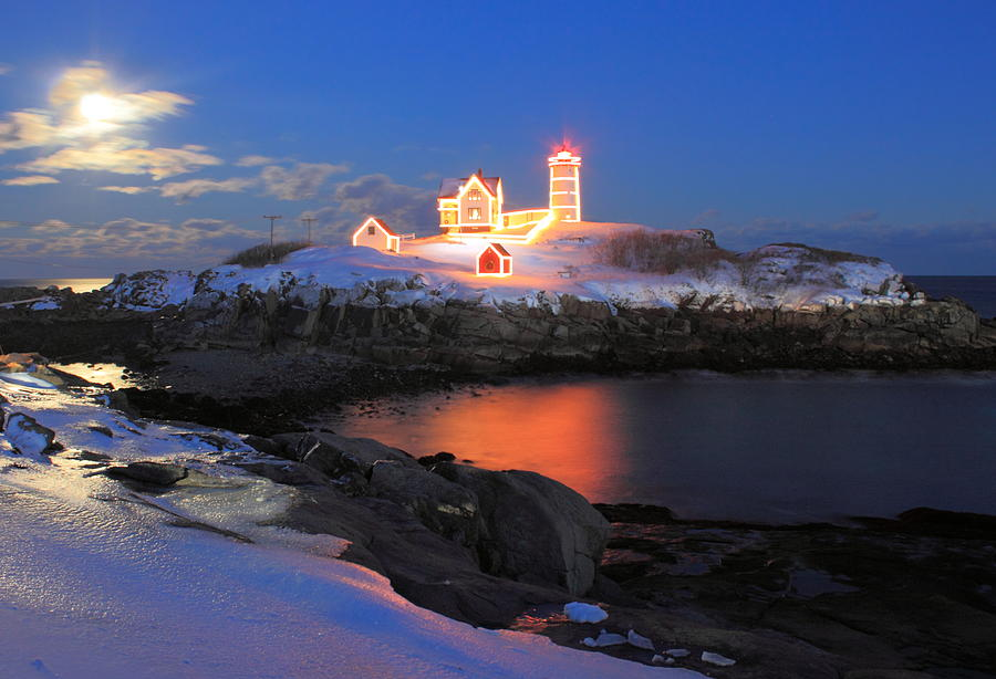 Nubble Lighthouse Photograph - Nubble Lighthouse Holiday Lights And Winter Moon by John Burk