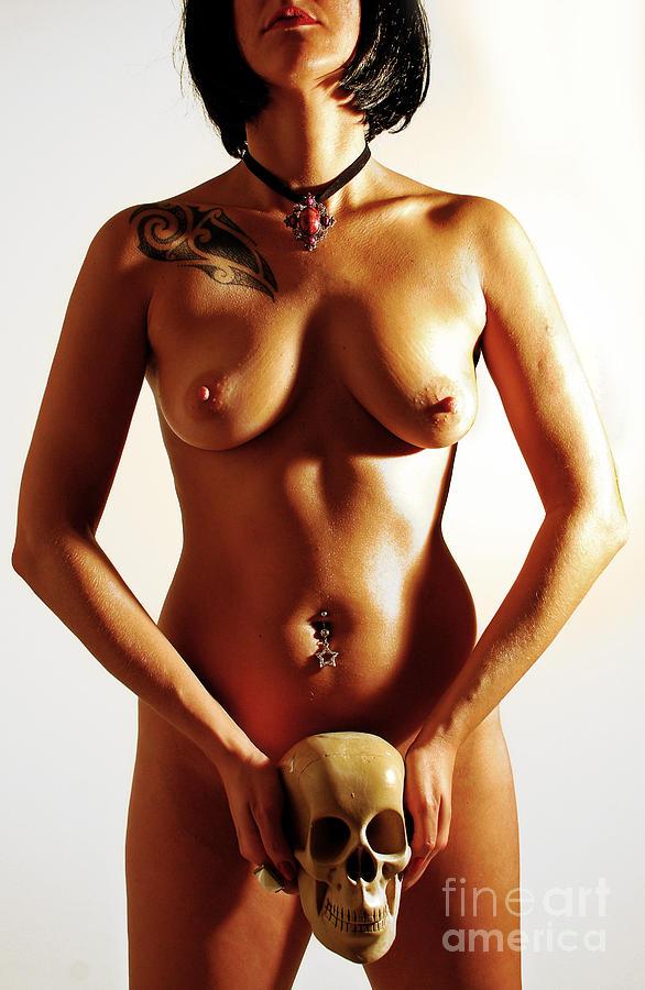 naked woman holding skull