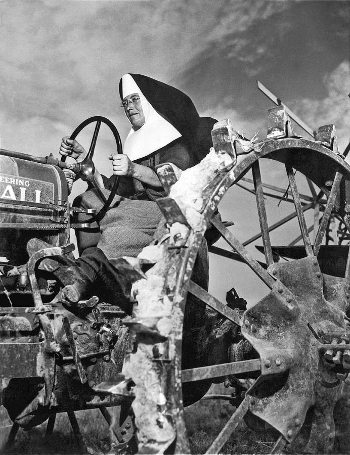 1942 Photograph - Nun Runs Tractor On Farm by Underwood Archives