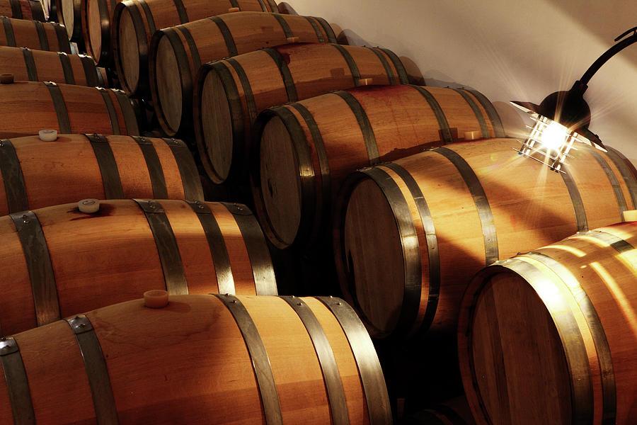 Oak Barrels In A Cellar Photograph by Seraficus