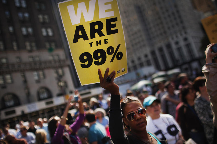 Occupy Wall Street Protestors March Down New Yorks Fifth Avenue Photograph by Spencer Platt