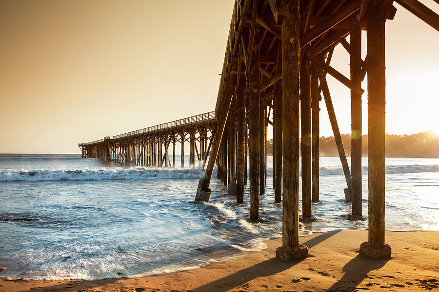 Ocean Pier Into The Sea Photograph by Pgiam