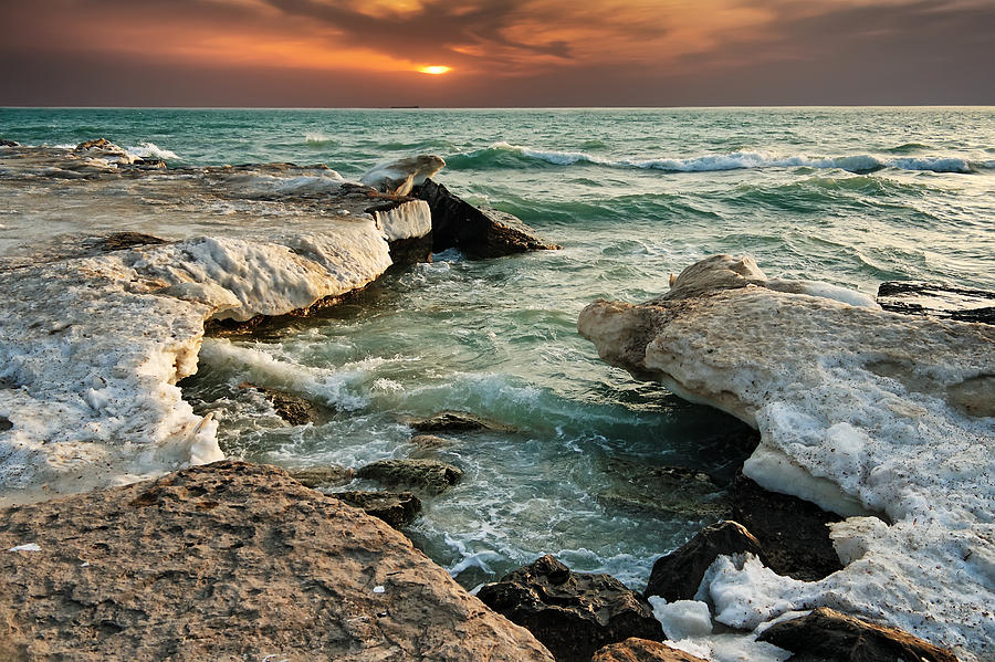 Beach Photograph - Ocean Waves Lapping At A Shoreline by Alexandr  Malyshev