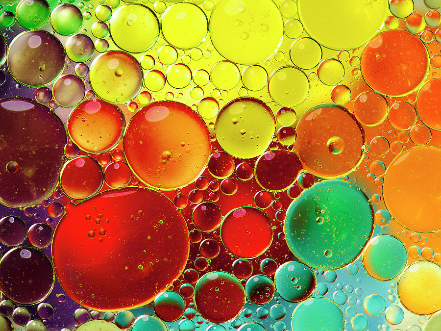 Oil Bubbles In Water Photograph by Ramoncovelo