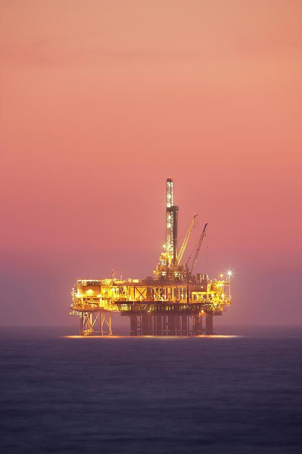 Oil Rig Platform In Twilight Photograph by Jimkruger