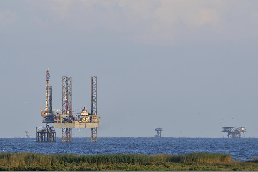 Oil Rig Photograph - Oil Rig Vewed From Shore by Bradford Martin
