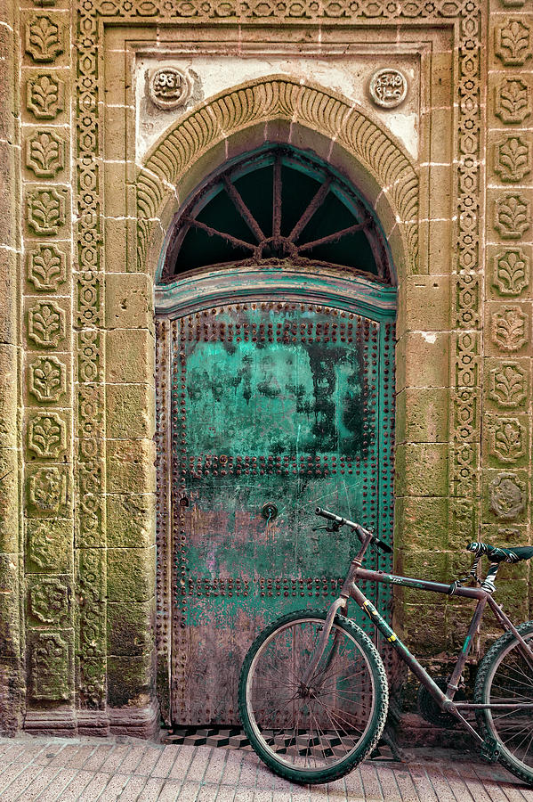 Old Bicycle In Front Of A Weathered Photograph by Haraldbiebel