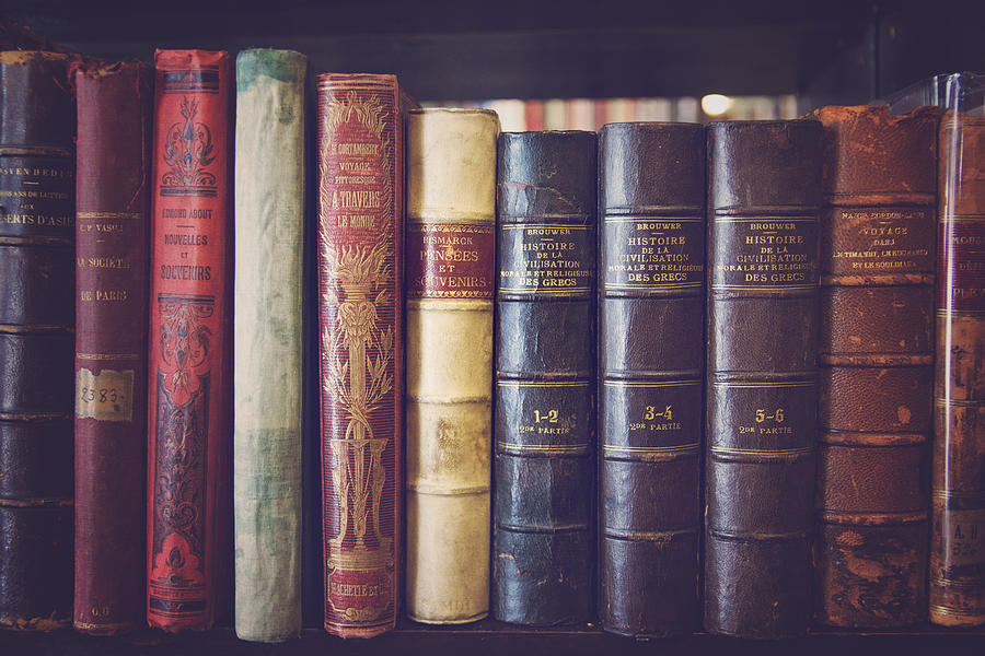 Old books in a library Photograph by Laura Battiato