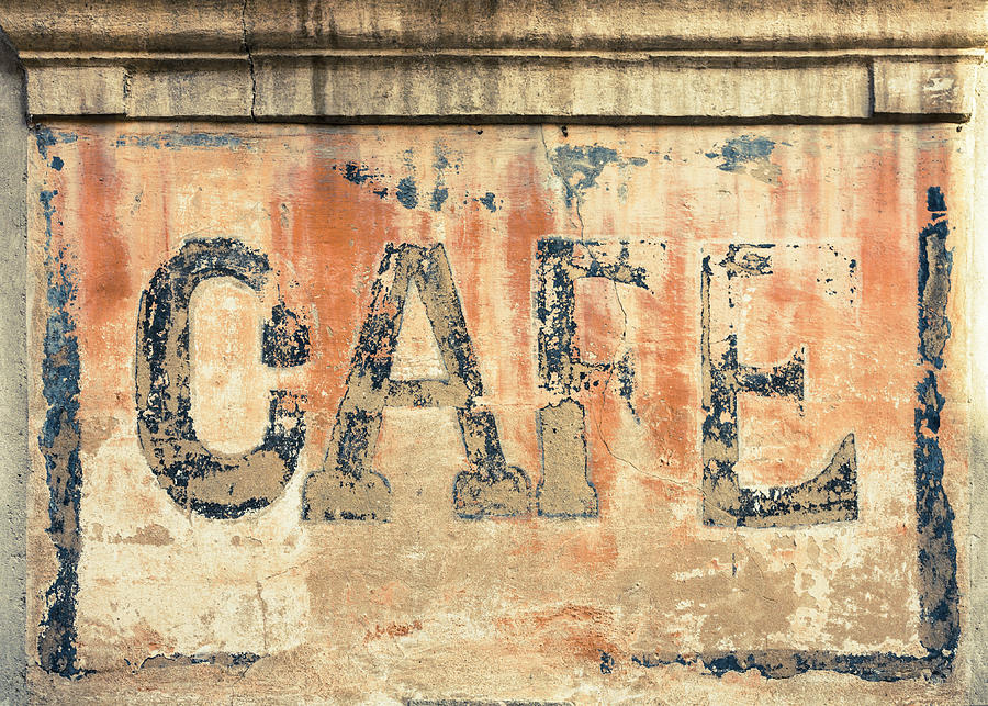 Old Cafe Sign On A Wall In France Photograph by Spooh