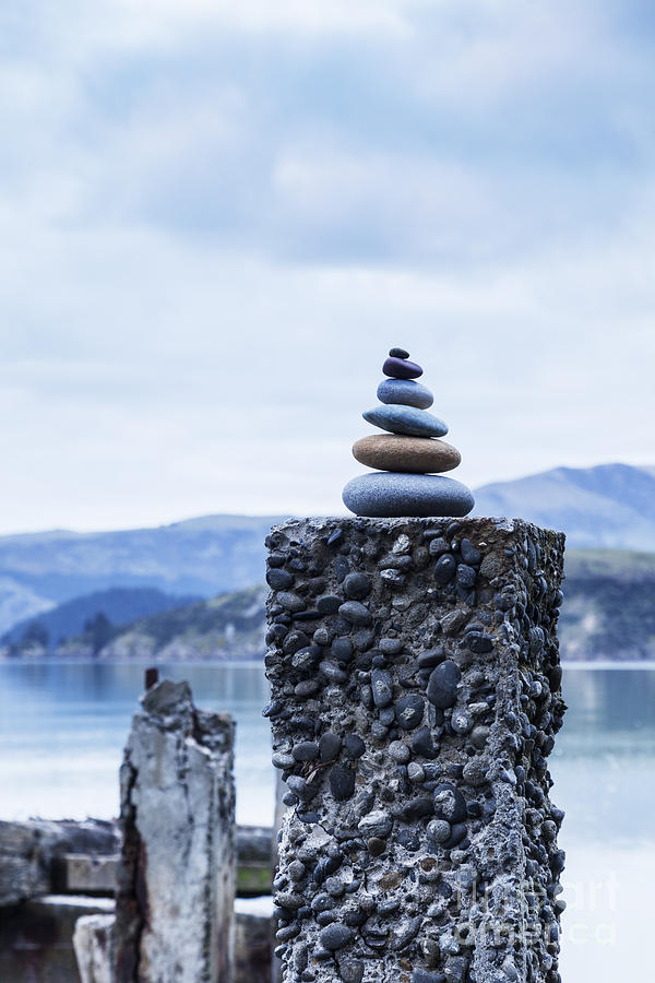 Cairn Photograph - Old Concrete Jetty Posts Governors Bay Banks Peninsula New Zealand by Colin and Linda McKie