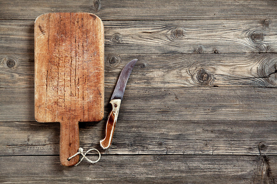 Old Cutting Board And Knife Photograph by Barcin