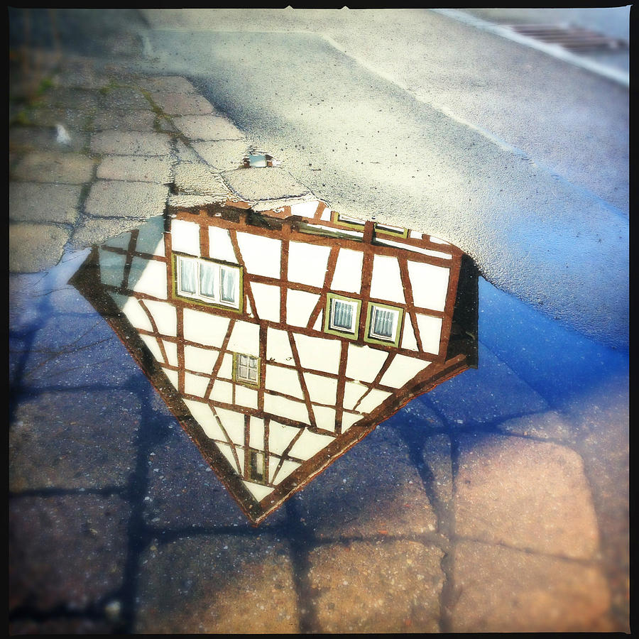Reflection Photograph - Old half-timber house upside down - water reflection by Matthias Hauser