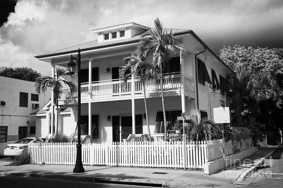 Old Photograph - Old Historic Wooden Two Storey Building With White Picket Fence Key West Florida Usa by Joe Fox