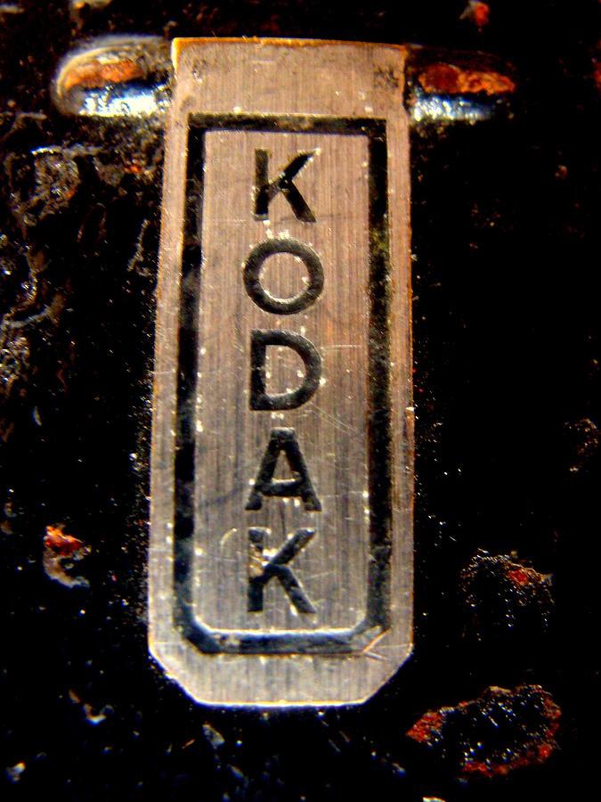 Object Photograph - Old Kodak Camera Emblem by Fethi Canbaz