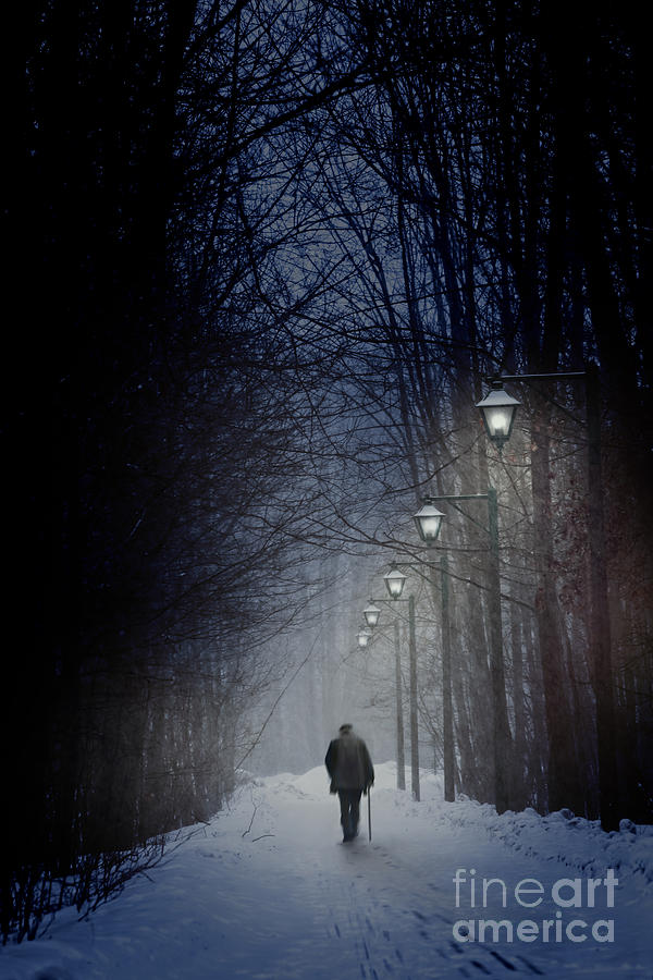 Old Man Walking On Snowy Winter Path At Night Photograph