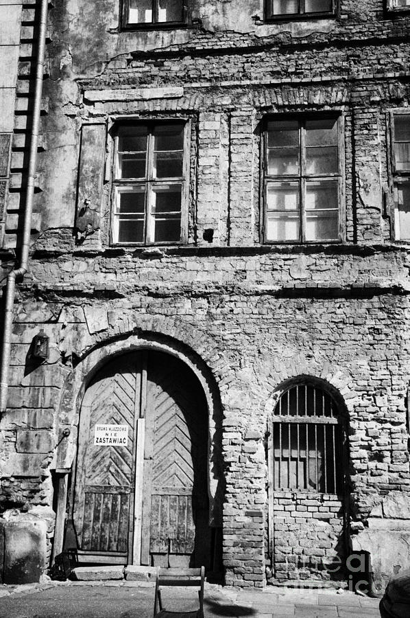 Europe Photograph - Old Red Brick Crumbling Building In Kazimierz District With Plaster Facade Removed To Expose Brickwork Krakow by Joe Fox