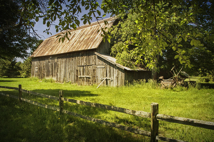 Old rustic barn and wooden fence photograph by randall nyhof